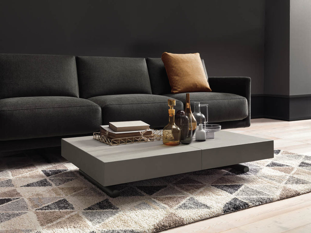 Cristallo transforms from a coffee table to a full-sized dining table.