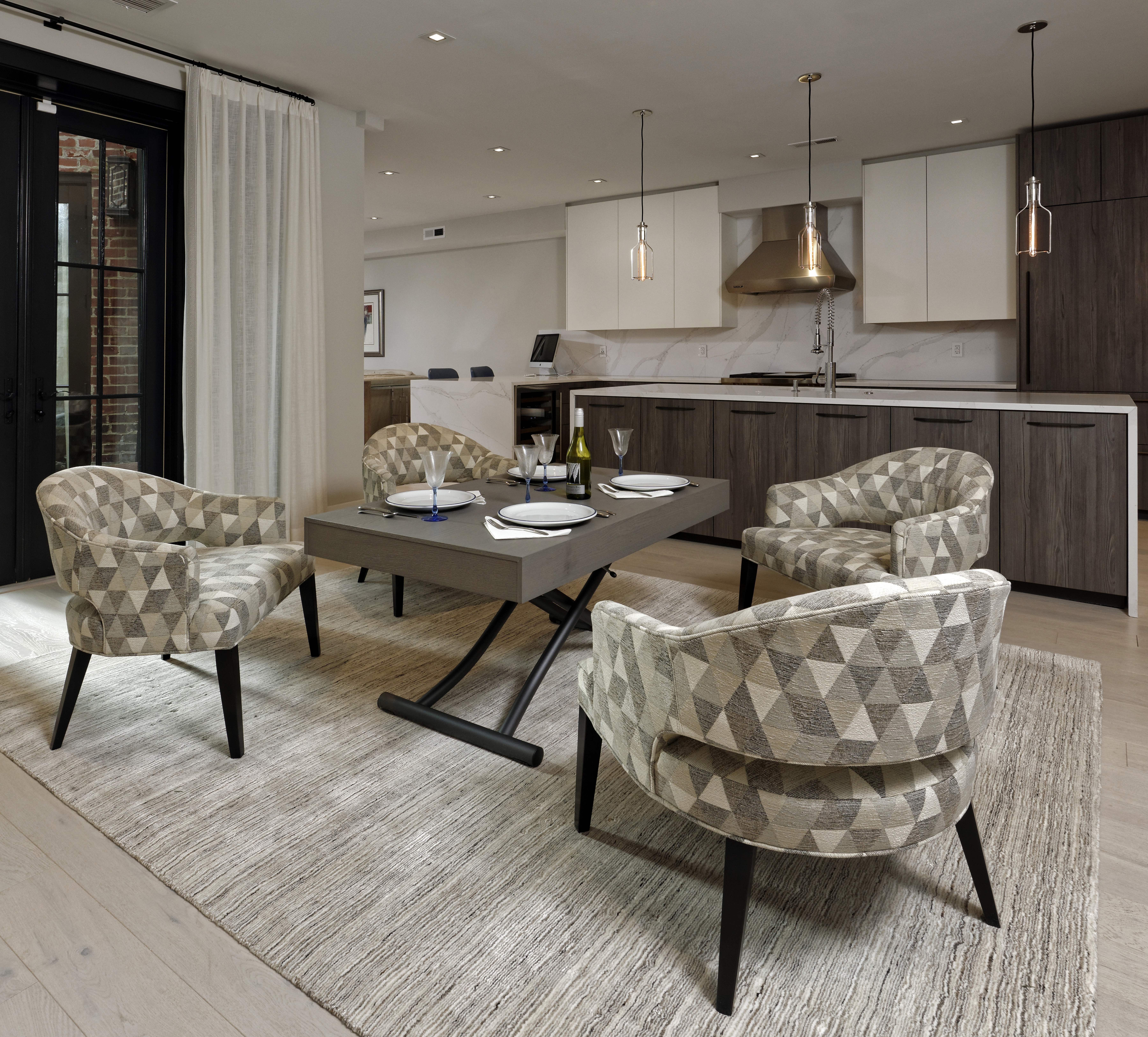 Our Passo height-adjusting coffee table was the perfect fit for this flexible seating / dining area off the kitchen.