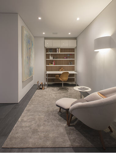 A rotating LGM wall bed let's this room function as both a home office and a guest space for grandkids. Designed by Andrea Charalambous.