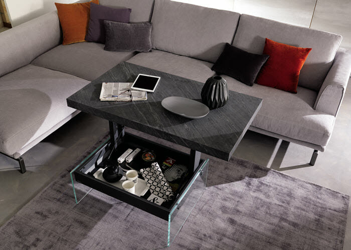 Tesoro coffee table features a hidden storage bin. When raised, the top comes up to a comfortable height workspace.