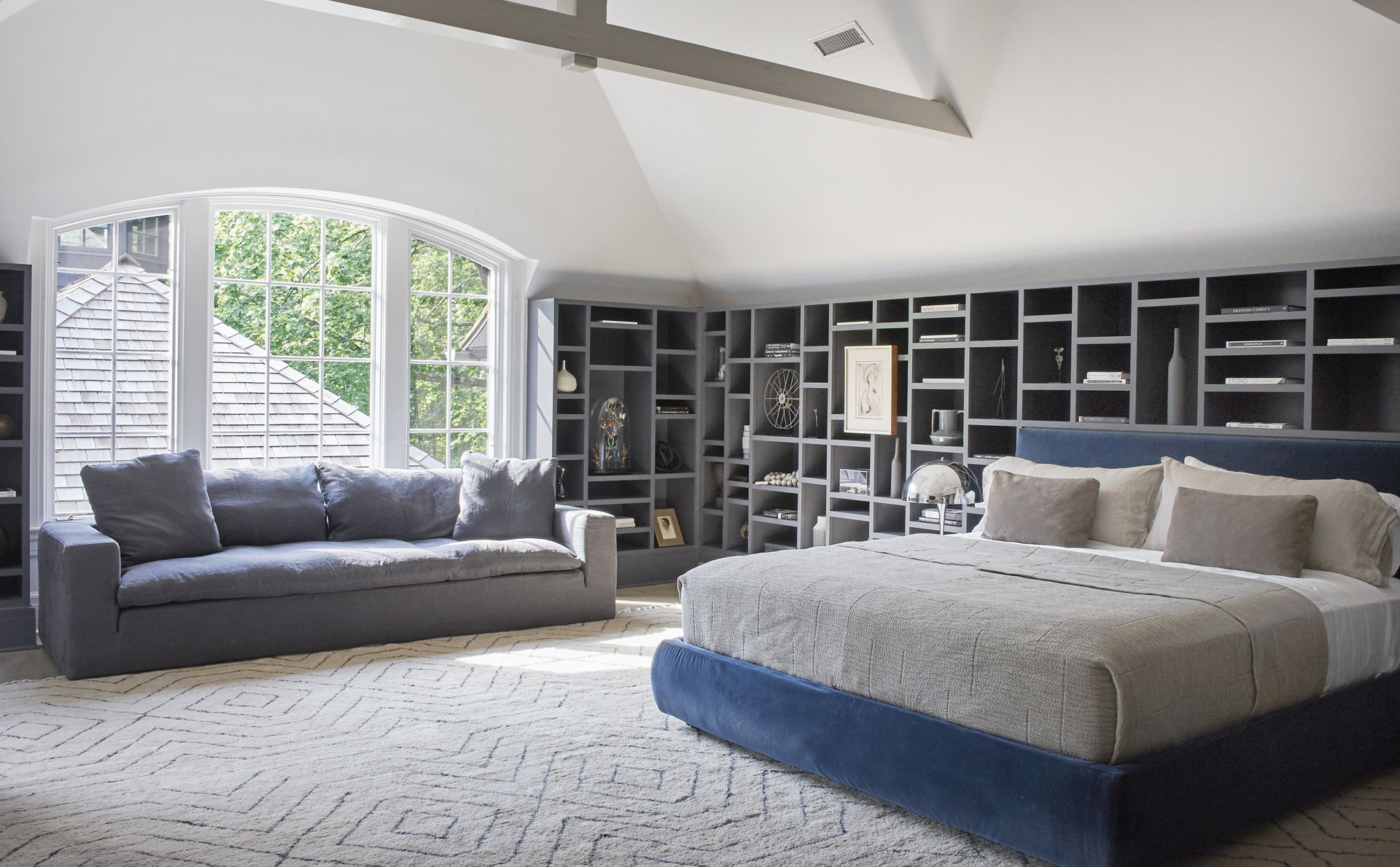 Square Line Sofa and Indy Storage Bed grace the master suite.