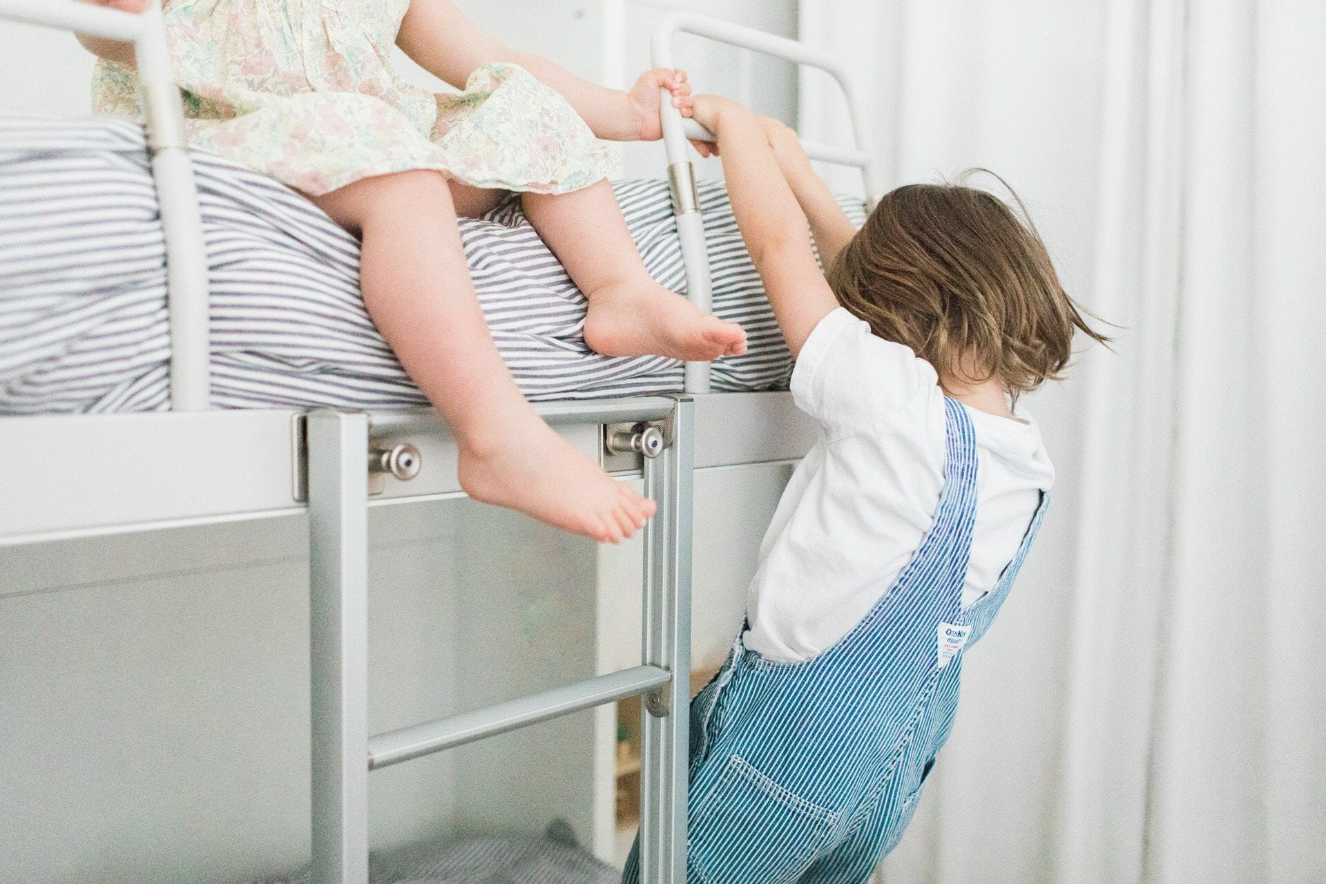 Kids Theo (age 5) and Mae (age 3) having fun on their Kali Duo bunk wall bed.