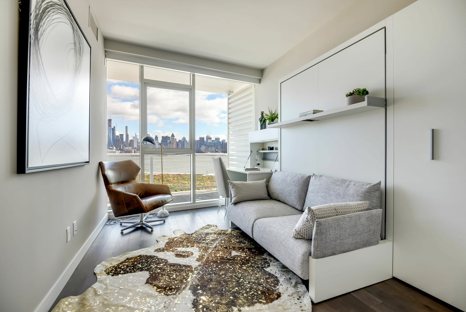 A small but luxurious <i>pied á terre</i>-style apartment at the Avora in Weehawken, New Jersey, looking out over the New York City skyline.