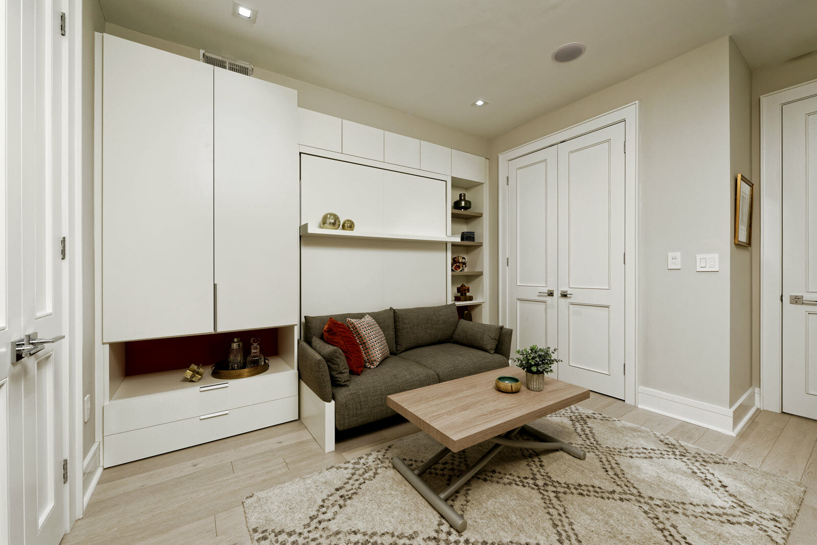 The Nuovoliola wall bed with sofa adds to this room's functionality without cluttering it. Designed by Theresa Boland.