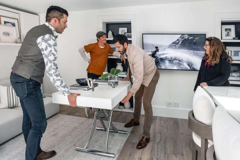 Jonathan and Drew demonstrate Resource Furniture's Passo table for Jean Ann Black, Brad Pitt's longtime friend and makeup artist.