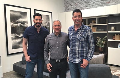 Resource Furniture's Ron Barth flanked by the Property Brothers, aka Jonathan and Drew Scott.
