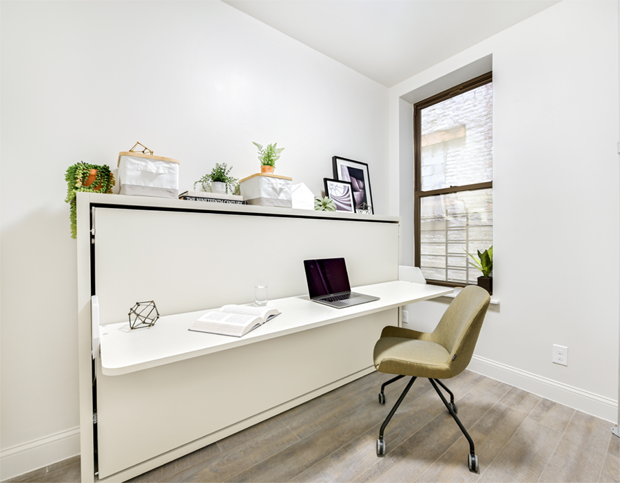 The Kali Board is a single-size wall bed with a unique pivoting mechanism that keeps the desk level with the floor, even when the bed is opened.
